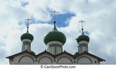 Green domes with Orthodox crosses of the monastery on the...