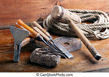 Vintage woodworking tools on wooden background