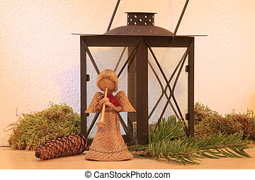 Christmas angels, candles, pine branches, moss