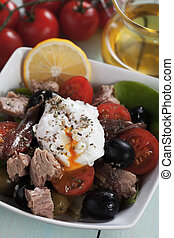 Salad nicoise with poached egg