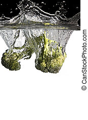 brocoli in water - brocoli thrown in water with black and...
