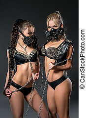 Hot dancers in studded costumes and respirators - Hot female...