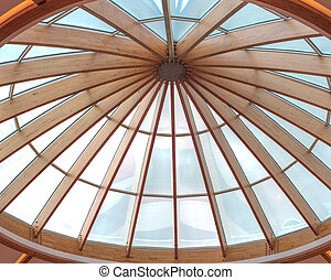 Timber beams of a roof forming a circular skylight