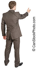 Back view of businessman in suit out to shake hand