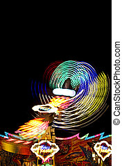 fast merry-go-round by night with great lights
