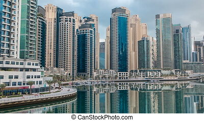 View of Dubai Marina Towers in Dubai at morning time timelapse