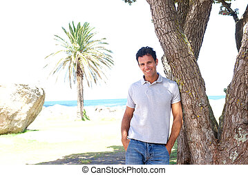 Smiling middle aged man standing outdoors