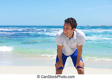 Smiling middle aged man at the beach