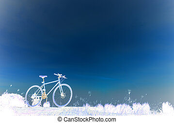 Sunset silhouette and bicycle on beautiful sky
