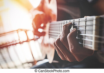 boys hand with a guitar