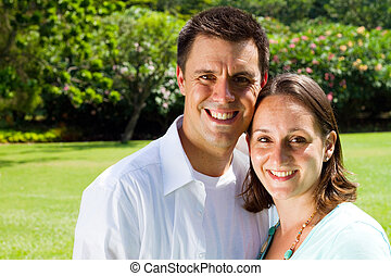 happy young couple - portrait of a happy young couple in...