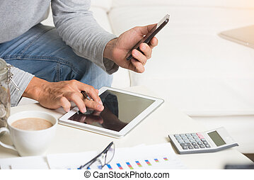 close up of man doing finance at home