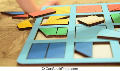 Boy and wooden learning game - Close-up shot of a little...