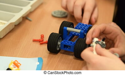 Children making robot from meccano set - Close-up shot of...