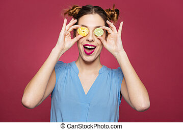 Happy funny young woman covered her eyes with marmalade...