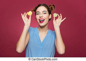 Cheerful beautiful young woman smiling and holding jelly...