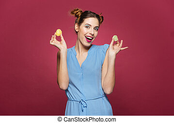 Joyful attractive young woman standing and holding marmalade...
