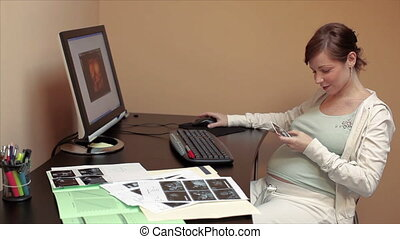 pregnant woman looking at scans