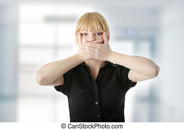 Young woman covering her mouth with hand, isolated on white...