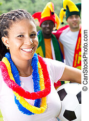 happy female soccer fan - a happy female african soccer fan...