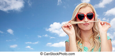 happy young woman making mustache with her hair - emotions,...