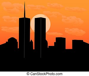 twin towers at sundown in the evening with clouds