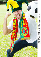 portugal soccer supporter - an enthusiastic portuguese...