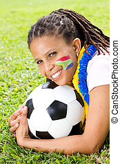 cheerful south african soccer fan - a cheerful south african...