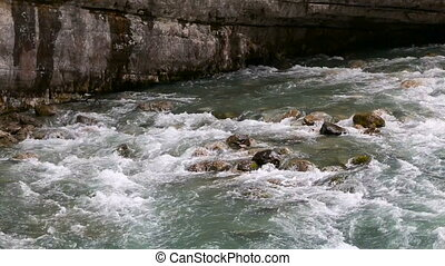 rapid mountain river in Abkhazia in the spring morning, the...