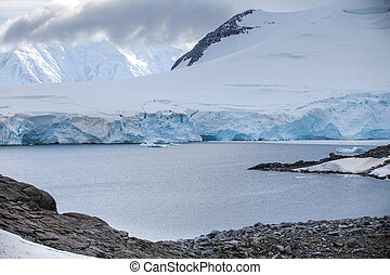 Landscape of the coast on ice-covered mountainous island off...