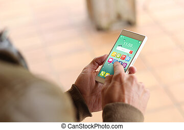 Brown young man smartphone - man touching the screen of his...