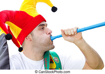 football fan blowing vuvuzela - a young male football fan...