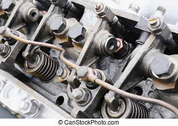 springs on the cylinder head of the engine of the tractor