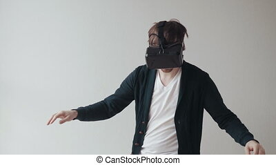 Man Using The Virtual Reality Headset, Doing Movements,...