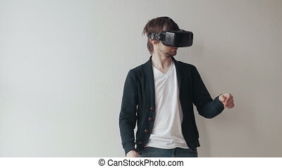Man Using The Virtual Reality Headset, Doing Gestures And...