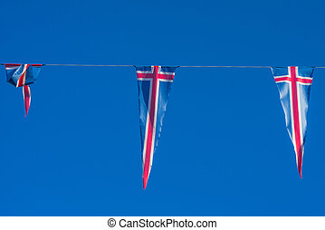 Flags of Iceland on a wire in blue sky