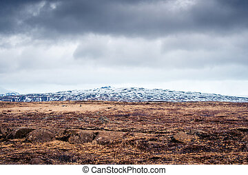 Cloudy weather over a rough field at a mountain