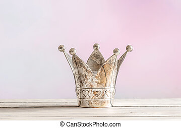 Royal crown on pink background - Royal crown on a wooden...