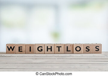 Weightloss sign in a bright room - Weightloss sign with...