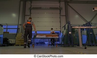 people working in warehouse, camera tracking