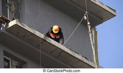 construction worker in a yellow hard hat, daylight