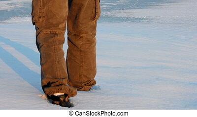 Man walking through snow