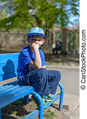 Patient young boy sitting waiting