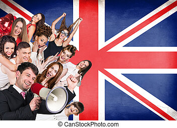 Happy group of diverse students standing on the britain flag...