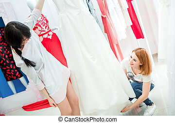bride selects the wedding dress - the bride selects the...