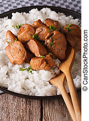 Philippine cuisine: Adobo with rice close-up. vertical