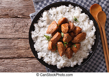 Philippine Adobo chicken with rice horizontal view from above