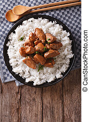 Philippine Adobo chicken with rice vertical view from above