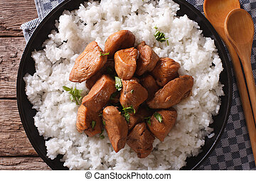 Adobo Chicken with a side dish of rice close-up. horizontal top view