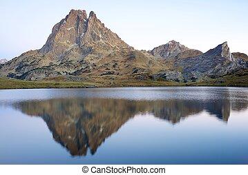 Pyrenees - Midi Dossau Peak reflected in Ayous lake Ossau...